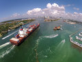 Cargo ship enters port aerial view Royalty Free Stock Photo