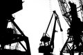 Cargo ship lifting cranes on the river in the port black and white photo Royalty Free Stock Photo