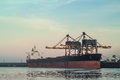 Cargo ship loading with coal in The Netherlands Royalty Free Stock Image