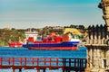 Cargo ship near the Belem tower, Lisbon Royalty Free Stock Photo