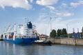 Cargo ship passing lock in Antwerp port