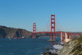 Cargo ship passing under the Golden Gate Bridge Royalty Free Stock Photo