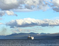 A cargo ship sailing up the beagle channel Royalty Free Stock Images