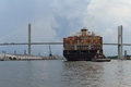 Cargo shipment a huge on its way through the savannah port and the memorial bridge usa Stock Photo
