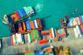 Cargo ships with containers at port terminal hong kong tilt sh shift blur effect aerial view loaded by crane a busy Royalty Free Stock Photo
