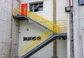 At the cargo terminal in the old Galeao airport, white building, ladder with yellow railing and red door. Rio de Janeiro, Brazil Royalty Free Stock Photo