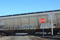 Cargo Train Crossing Over Road at Crossing Royalty Free Stock Photo