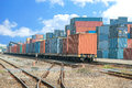 Cargo train platform with freight train container at depot Royalty Free Stock Photo