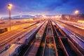 Cargo train platform at night - Freight trasportation Stock Photo