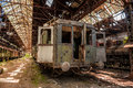 Cargo trains in old train depot left to be eaten by the rust Royalty Free Stock Photography