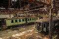 Cargo trains in old train depot left to be eaten by the rust Royalty Free Stock Images