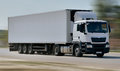 Cargo truck delivery in motion on road Stock Photos