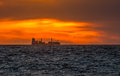 Cargo vessel in sunset freight rig ship silhouette at Royalty Free Stock Photography
