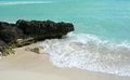 Caribbean beach in cancun mexico dark lava rock on a white sand Royalty Free Stock Photography