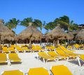 Caribbean beach in cancun mexico tropical resort amenities at a with white sand yellow chairs at the atlantic ocean Stock Photography