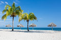 Caribbean beach with palms in cuba white sand and Royalty Free Stock Photos
