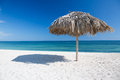 Caribbean beach with parasol in cuba white sand turquoise sea Stock Photos