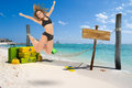 Caribbean getaway young woman jumping in a beach resort Stock Images
