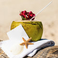 Caribbean paradise beach coconuts cocktail coconut starfish tropical refreshment and towel Royalty Free Stock Photography
