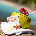Caribbean paradise beach coconuts cocktail coconut starfish tropical refreshment and towel Royalty Free Stock Photo