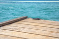 Caribbean peer a scene with a small dock deck stretching over the blue turquoise waters of the Royalty Free Stock Photography