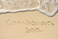 Caribbean Sea Written in Sand on Beach Royalty Free Stock Images