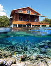 Caribbean stilt house and fish Stock Image