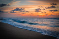 Caribbean sunset and a lonely surfer Royalty Free Stock Photo