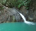 Caribbean waterfall a in lush vegetation on a island named guadeloupe Royalty Free Stock Photo