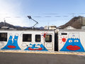 Caricatures of the volcano japan january cheerful passenger train with colorful transporting people to foot Stock Image