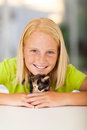 Caring girl pet teen playing with kitten at home Royalty Free Stock Image