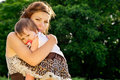 Caring, mother hugs baby Royalty Free Stock Photo