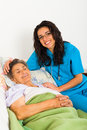 Caring nurses for elderly patients suffeing from disease in nursing home Royalty Free Stock Photos