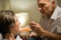 Caring senior man feeding his sick wife Royalty Free Stock Photo