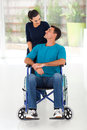 Caring wife talking to disabled husband home Royalty Free Stock Photography