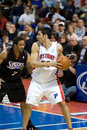 Carlos delfino is gurarded by andre miller of the detroit pistons guarded during a game against the philadelphia ers at the the Royalty Free Stock Photography