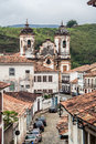 Carmo church ouro preto the baroque housing at a typical street in minas gerais brazil the facade of the twin towers of in the Royalty Free Stock Image