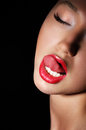 Carnality. Lust. Provocative Woman Licking her Red Sexy Lips. Passion Royalty Free Stock Photo