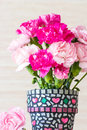 Carnation in mosaic flower pot on white background Royalty Free Stock Photo