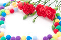 Carnations and colorful balls Royalty Free Stock Photo