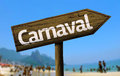 Carnaval wooden sign on the beach Royalty Free Stock Photo