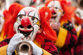 Carnival clowns playing trumpet colorful clown group the at basel fasnacht festival Royalty Free Stock Image