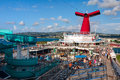 Carnival Conquest large cruise ship was docked at the coast of Jamaica. Panoramic view from the upper pool deck. Royalty Free Stock Photo