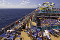 Carnival Cruise Ship - Relaxing on Deck Royalty Free Stock Photo
