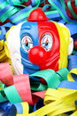 Carnival face of clown in the foreground with confetti Royalty Free Stock Photos