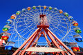 Carnival fairground ferris wheel a brightly coloured Royalty Free Stock Photo
