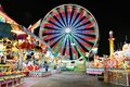 Carnival and Ferris Wheel at Night - Bright Lights and Long Exposure Royalty Free Stock Photo