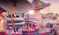 Carnival fun time day at the fair with rides in cool retro vintage tones Stock Photography
