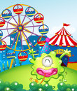 A carnival at the hilltop at the back of the green monster illustration Stock Image