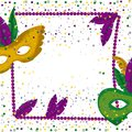 Carnival mardi gras poster with purple necklace frame with feathers and mask green and yellow over colorful confetti Royalty Free Stock Photo